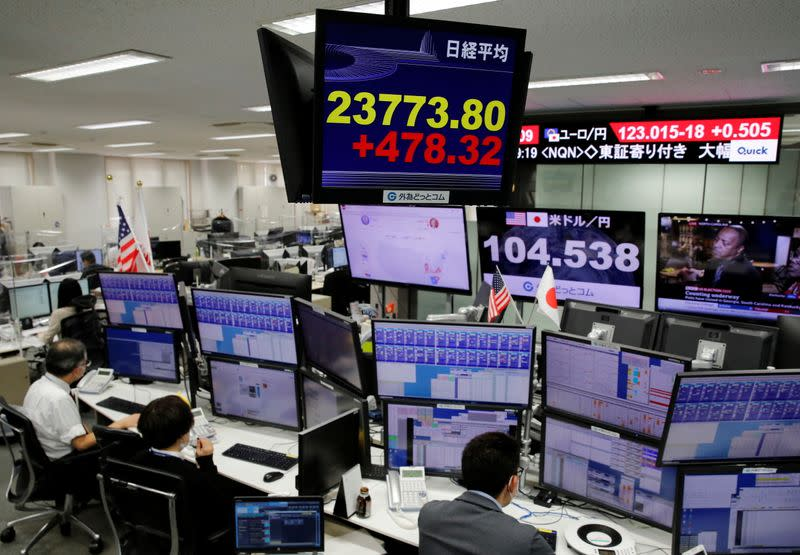 A monitor shows Nikkei stock index at a foreign exchange trading company in Tokyo
