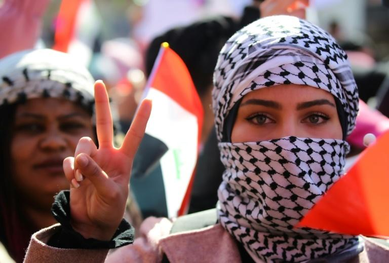 """""""Revolution is my name, male silence is the real shame!"""" they chanted, then adding """"Freedom, revolution, feminism!"""" (AFP Photo/AHMAD AL-RUBAYE)"""