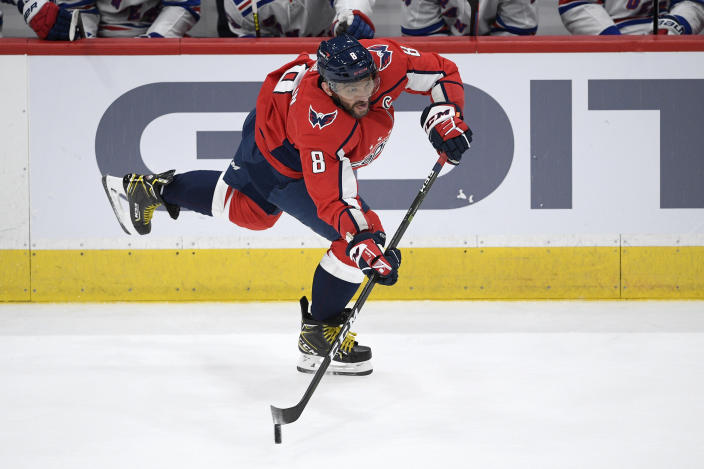 Washington Capitals left wing Alex Ovechkin (8) passes the puck during the second period of an NHL hockey game against the New York Rangers, Sunday, March 28, 2021, in Washington. (AP Photo/Nick Wass)