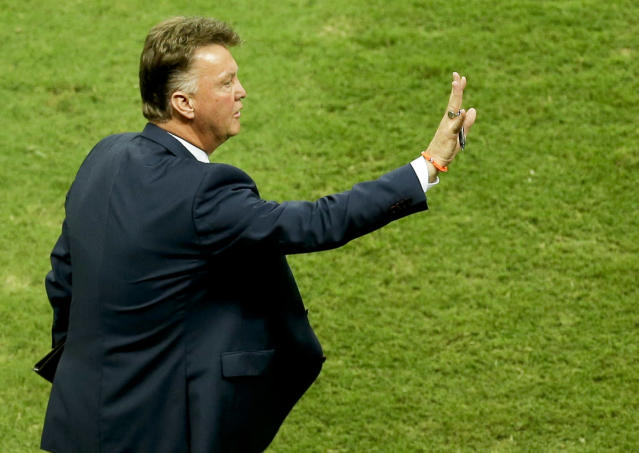 Netherlands' head coach Louis van Gaal gives indications during the World Cup quarterfinal soccer match between the Netherlands and Costa Rica at the Arena Fonte Nova in Salvador, Brazil, Saturday, July 5, 2014. (AP Photo/Themba Hadebe)