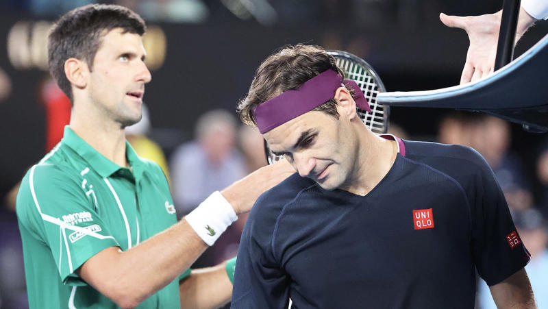 Novak Djokovic (pictured left) shakes hands with the umpire, while Roger Federer looks disappointed.