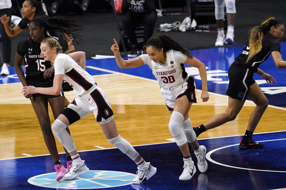 Stanford guard Haley Jones (30) celebrates after making a basket during the second half of a women's Final Four NCAA college basketball tournament semifinal game against South Carolina Friday, April 2, 2021, at the Alamodome in San Antonio. (AP Photo/Eric Gay)