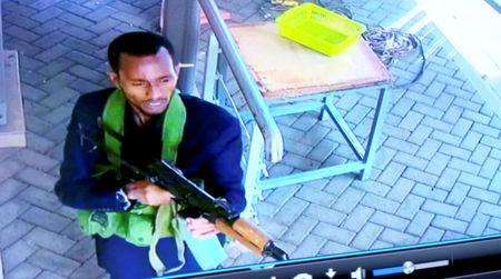 A gunman is pictured as he and others make their way into a hotel and office complex in Nairobi, Kenya, January 15, 2019, in this still image taken from a CCTV footage obtained by Reuters TV Janaury 16, 2019. REUTERS/Reuters TV