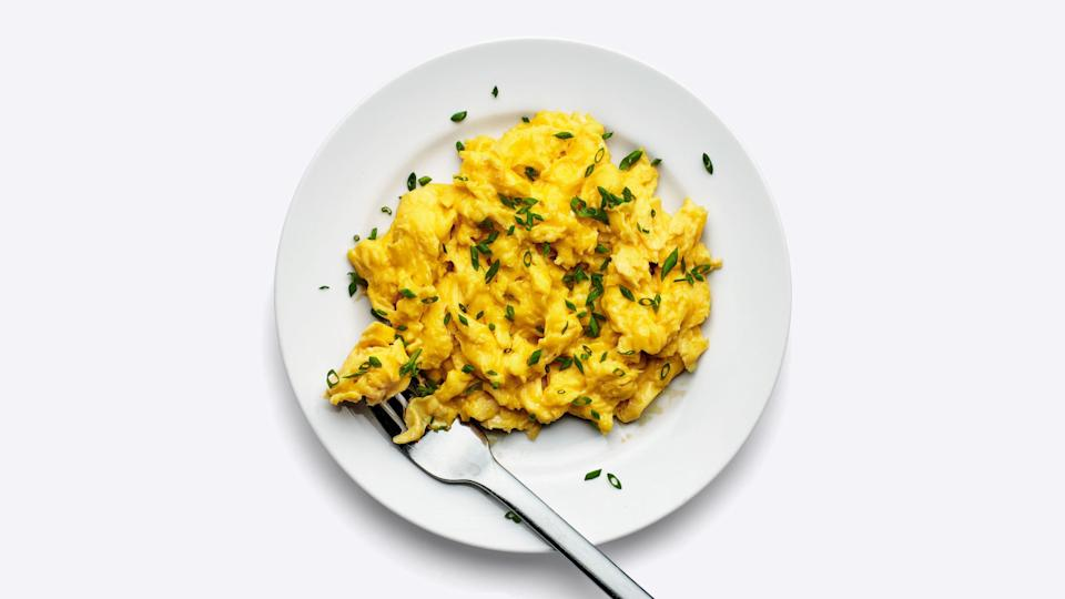 """To ensure your eggs are uniformly seasoned and as soft and luscious as possible, add salt when you whisk them together, not when they're in the pan or on the plate. According to food scientist <strong>J. Kenji López-Alt</strong>, salt inhibits the proteins in the eggs from binding too tightly as they heat up, which means your scramble will have a moister, more tender curd and be less likely to weep. In an ideal world, you'd incorporate salt 15 minutes before you start cooking so the granules can dissolve into the mix, but even a minute can make a difference. <a href=""""https://www.bonappetit.com/story/a-simple-trick-for-more-tender-scrambled-eggs?mbid=synd_yahoo_rss"""" rel=""""nofollow noopener"""" target=""""_blank"""" data-ylk=""""slk:See article."""" class=""""link rapid-noclick-resp"""">See article.</a>"""