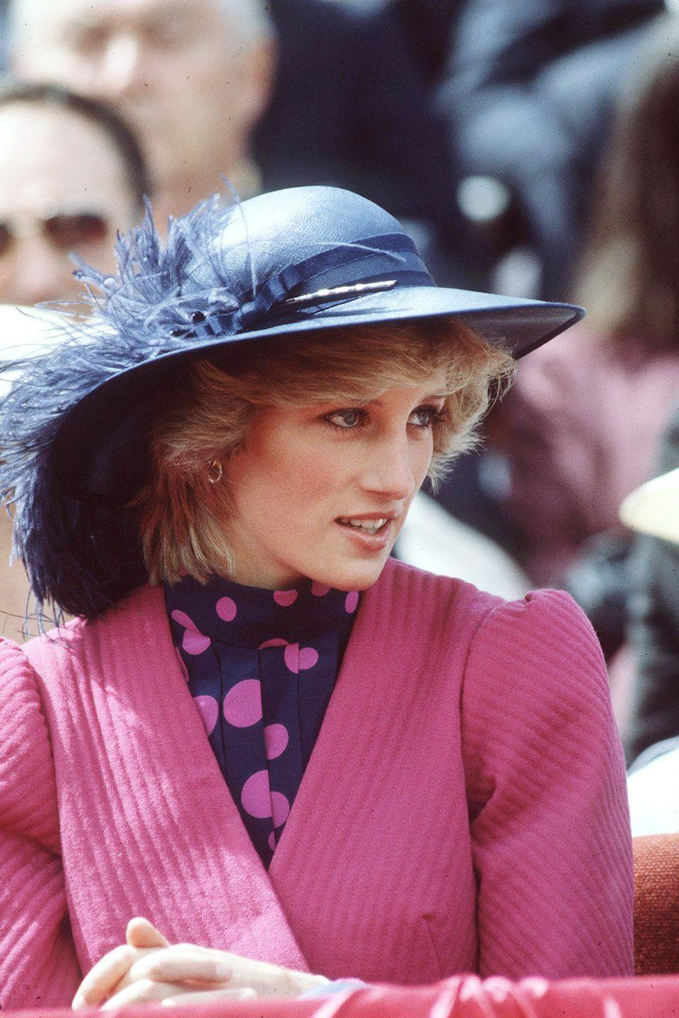 <p>Wearing a deep blue wide brim topper with a feather at her birthday celebration in Canada.</p>