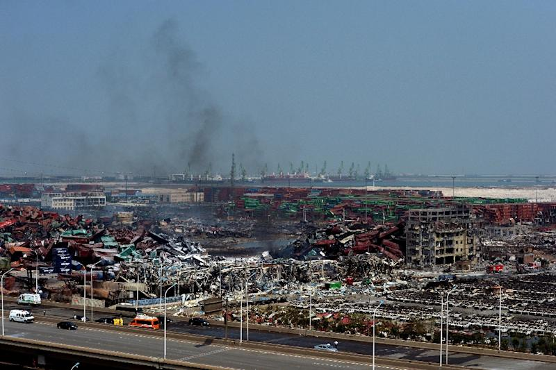 165 people died in massive explosions at a chemical storage facility in the Chinese city of Tianjin that devastated a swathe of the northern port in August 2015 (AFP Photo/)
