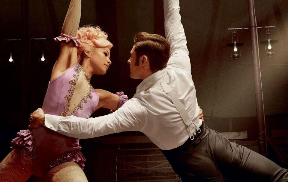 Zendaya plays Anne Wheeler, one of the trapeze artists who joins the circus and soon falls in love with Zac's character Phillip Carlyle, a business partner of Barnum's. Source: 20th Century Fox