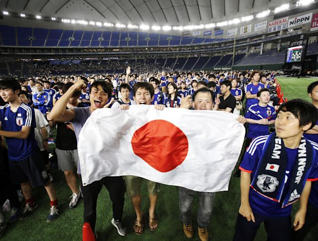 Japan's fans cheer as they watch a broadcast of the World Cup Group H soccer match Colombia vs Japan, at a public viewing event at Tokyo Dome in Tokyo, Japan June 19, 2018. REUTERS/Issei Kato