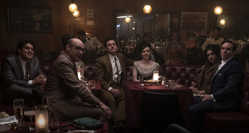 """Samson Moeakiola as Pussy Bonpensiero, Corey Stoll as Junior Soprano, Billy Magnussen as Paulie Walnuts, Michela De Rossi as Giuseppina Moltisanti (second from right) and Alessandra Nivola as Dickie Moltisanti in New Line Cinema and Home Box Office's mob drama """"The Many Saints of Newark,"""" a Warner Bros. Pictures release. (Barry Wetcher/Warner Bros. Entertainment Inc.)"""