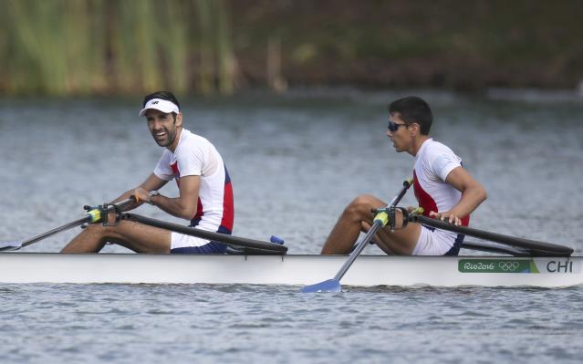 2016 Rio Olympics - Rowing - Semifinal - Lightweight Men's Double Sculls Semifinal C/D 2 - Lagoa Stadium - Rio De Janeiro, Brazil - 11/08/2016. Felipe Cardenas Morales (CHI) of Chile and Bernardo Guerrero Diaz (CHI) of Chile react. REUTERS/Carlos Barria FOR EDITORIAL USE ONLY. NOT FOR SALE FOR MARKETING OR ADVERTISING CAMPAIGNS.
