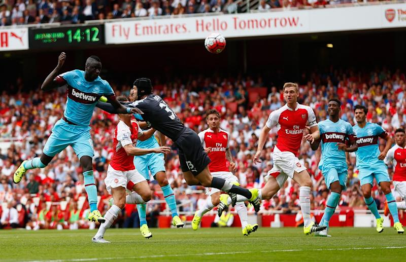 Kouyate beats Petr Cech to head home West Ham's opener against Arsenal in August 2015