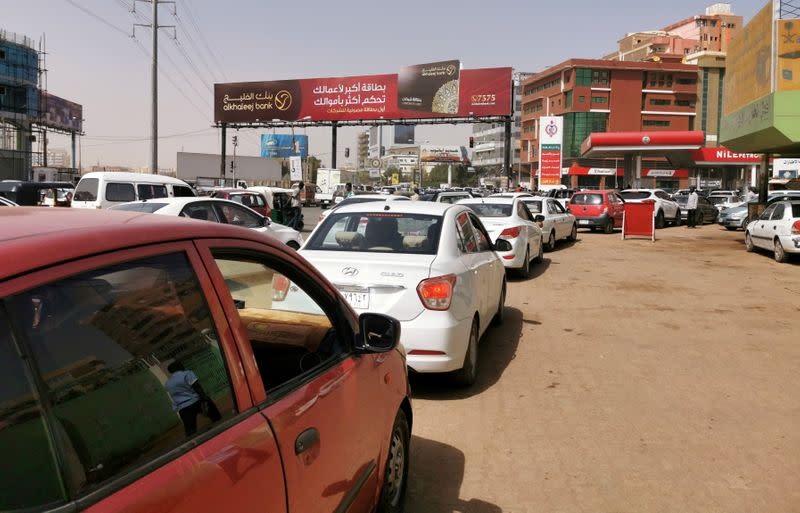 FILE PHOTO: Motorists queue for fuel at a fuel station in Khartoum