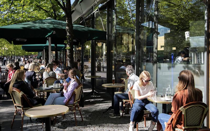 Cafes, schools, bars and restaurants have all stayed open in Sweden during the pandemic - Loulou D'Aki/Bloomberg