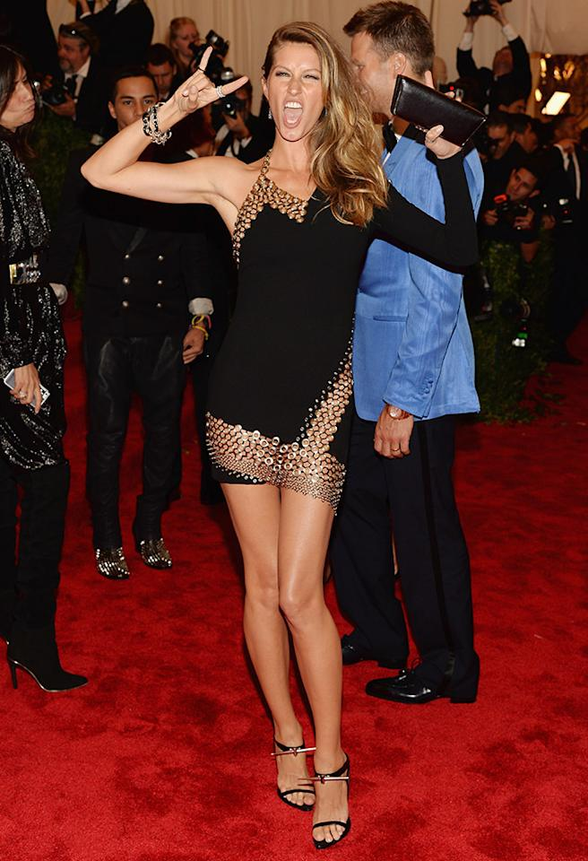 Supermodel mom Gisele Bundchen turned heads while rocking out in this Anthony Vaccarello mini.