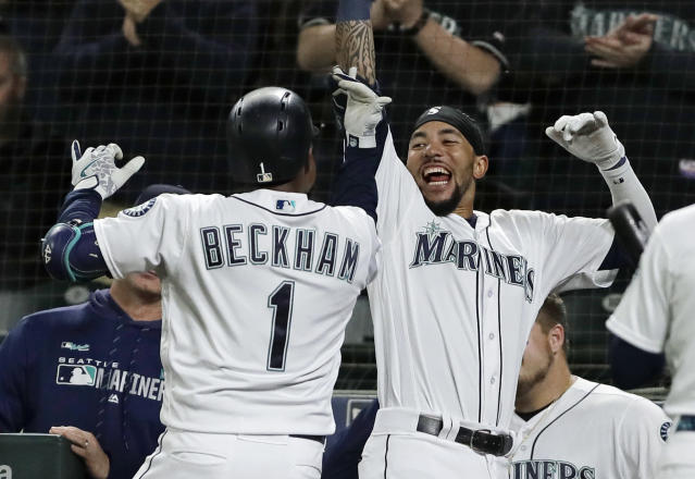 Seattle Mariners' Tim Beckham (1) celebrates with J.P. Crawford, right, after Beckham hit a go-ahead solo home run during the eighth inning of a baseball game against the St. Louis Cardinals, Tuesday, July 2, 2019, in Seattle. (AP Photo/Ted S. Warren)