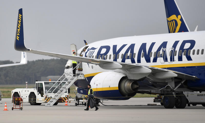 A Ryanair jetplane parks at the airport in Weeze, Germany, Wednesday, Sept. 12, 2018. Ryanair is canceling dozens of flights after pilots and flight attendants started a one-day strike over pay and conditions. (AP Photo/Martin Meissner)