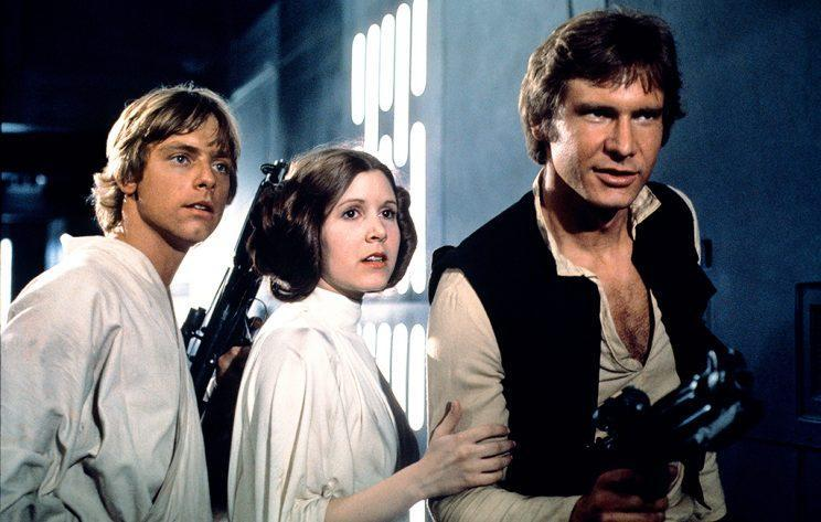 <p>Fisher as Princess Leia, her most notable, world-famous role, with Mark Hamill and Harrison Ford, 1977. Fisher recently admitted to having had an affair with Ford during the filming, at a time when he was married. (Photo: Everett Collection)</p>