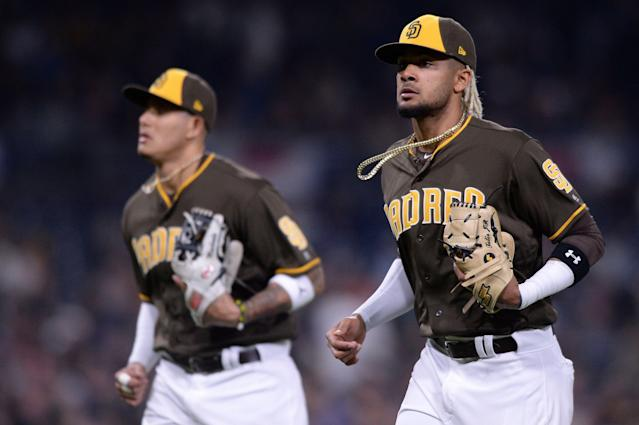 The future is now in San Diego, after Manny Machado (left) and Eric Hosmer helped talk Padres owner Ron Fowler into promoting Fernando Tatis Jr. (AP Photo/Orlando Ramirez)