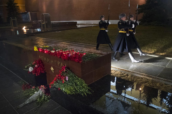 <p>The Kremlin guards in Moscow change next to candles and flowers placed in memory of victims killed by a bomb blast in a subway train in St. Petersburg at the memorial stone with the word Leningrad (St. Petersburg) at the Tomb of Unknown Soldier in front of the Kremlin wall Monday, April 3, 2017. A bomb blast tore through a subway train in Russia's second-largest city Monday, leaving several killed and more injured as President Vladimir Putin visited the city, authorities said. (Pavel Golovkin/AP) </p>