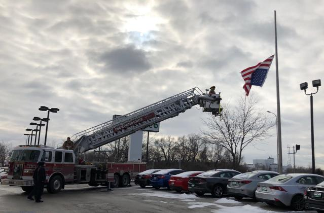 A police officer called in reinforcements to help fix an upside-down American flag. (Photo: Facebook)