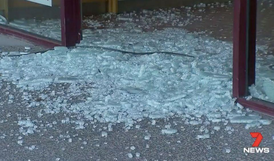 The gang smashed through the doors of the bakery. Photo: 7 News