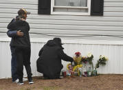Mourners organize a memorial, Monday, May 10, 2021, outside a mobile home in Colorado Springs, Colo., where a shooting at a party took place a day earlier that killed six people before the gunman took his own life. (Jerilee Bennett/The Gazette via AP)