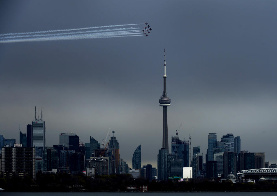 The Canadian Snowbirds circle the CN Tower as part of Operation Inspiration during the COVID-19 pandemic in Toronto on Sunday, May 10, 2020. (Nathan Denette/The Canadian Press via AP)