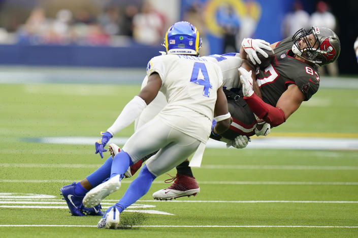 Tampa Bay Buccaneers tight end Rob Gronkowski , right, is tackled by Los Angeles Rams linebacker Terrell Lewis during the second half of an NFL football game Sunday, Sept. 26, 2021, in Inglewood, Calif. (AP Photo/Jae C. Hong)