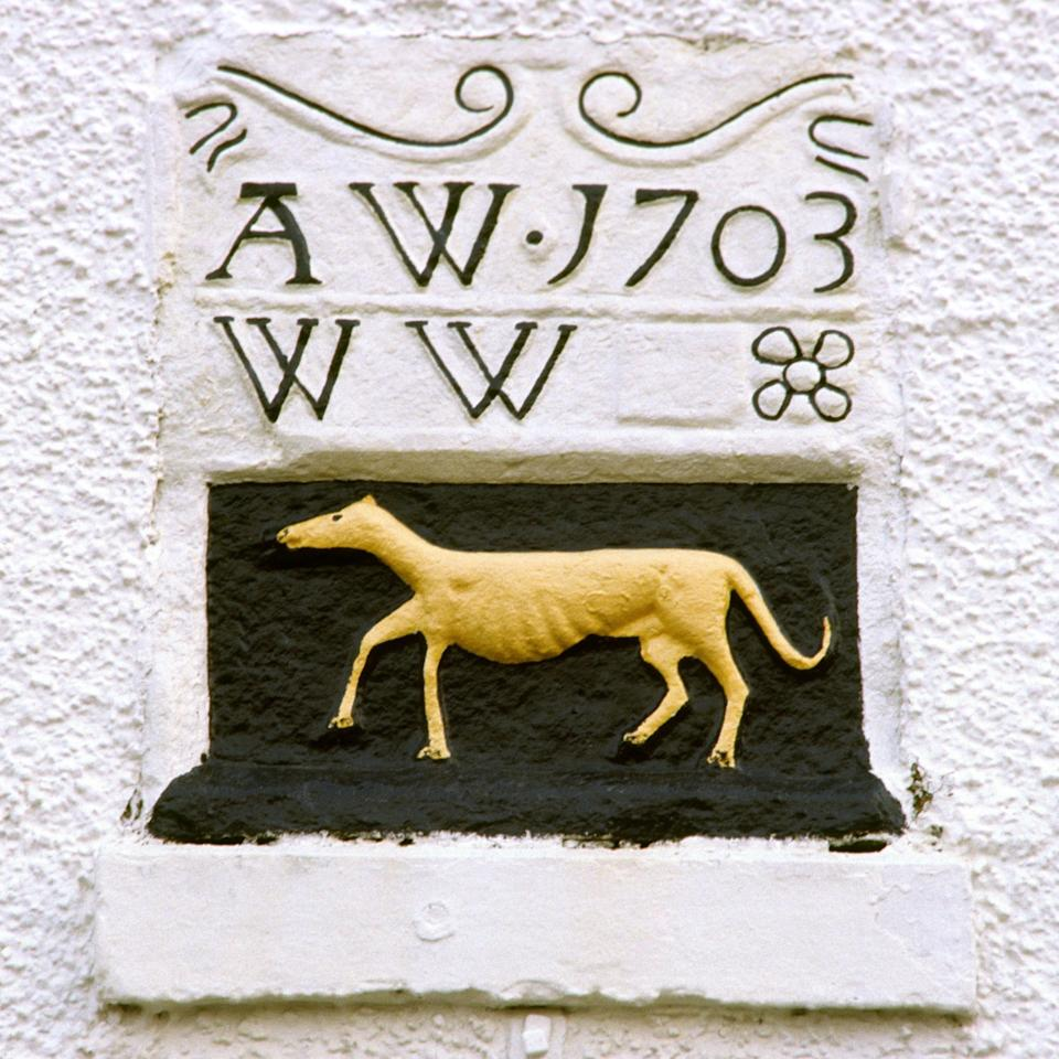 Dying breed: the historic sign of the Greyhound Hotel in Shap, Cumbria, dating from 1703 - Alamy