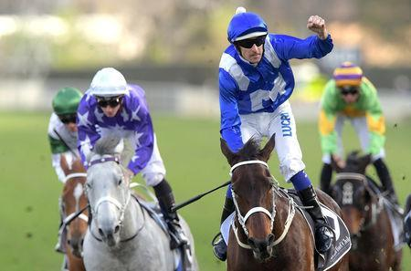 Jockey Hugh Bowman reacts as he rides champion thoroughbred Winx to a national record 26th win in succession to claim a Group 1 race named in her honour at Royal Randwick in Sydney, Australia, August 18, 2018. AAP/Simon Bullard/via REUTERS