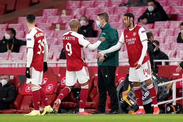 Pierre-Emerick Aubameyang, right, started on the bench