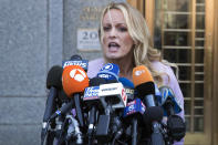 In this April 16, 2018 file photo, adult film actress Stormy Daniels speaks outside federal court in New York. Part of a criminal investigation by the New York District Attorney's Office pertains to payments made during President Trump's 2016 campaign to Daniels and model Karen McDougal to prevent them from publicly alleging they had extramarital affairs with him. . (AP Photo/Mary Altaffer, File)