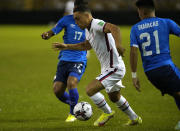 United States's Sergino Dest, center, controls the ball during a qualifying soccer match against El Salvador, for the FIFA World Cup Qatar 2022 at Cuscatlan stadium in San Salvador, El Salvador, Thursday, Sept. 2, 2021. (AP Photo/Moises Castillo)
