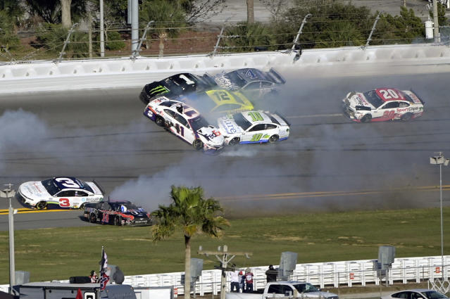 Kurt Busch (1), Denny Hamlin (11), Aric Almirola (10), Ryan Blaney (12) and Kevin Harvick (4) are involved in a multi-car collision between Turns 3 and 4 during the NASCAR Daytona Clash auto race at Daytona International Speedway, Sunday, Feb. 9, 2020, in Daytona Beach, Fla. (AP Photo/Phelan M. Ebenhack)