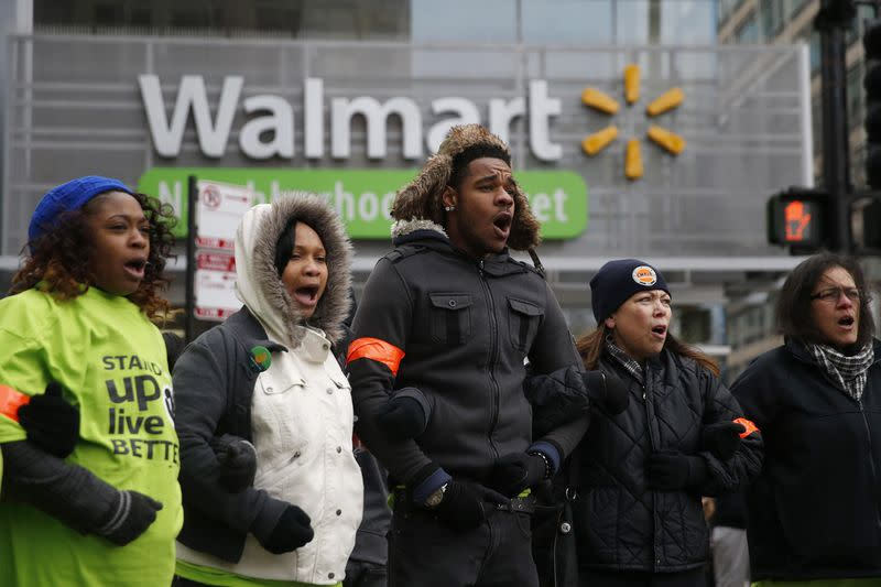 Wal-Mart protesters link arms during a demonstration in Chicago