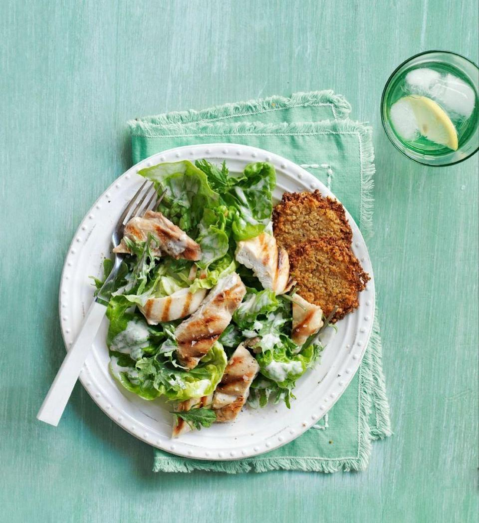 """<p>Folding fresh kale into a bed of romaine gives this classic salad a whole new textural makeover. A lighter Caesar dressing made with a yogurt base brings this savory classic down to 300 calories per bowl.</p><p><em><a href=""""https://www.womansday.com/food-recipes/recipes/a50554/kale-romaine-chicken-caesar-salad-recipe-wdy0615/"""" rel=""""nofollow noopener"""" target=""""_blank"""" data-ylk=""""slk:Get the recipe from Woman's Day »"""" class=""""link rapid-noclick-resp"""">Get the recipe from Woman's Day »</a></em></p>"""