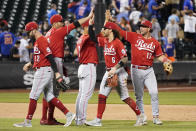 Cincinnati Reds' Tyler Naquin (12), Joey Votto (19), Eugenio Suarez (7), Jonathan India (6) and Kyle Farmer (17) celebrate after defeating the New York Mets in a baseball game, Friday, July 30, 2021, in New York. (AP Photo/Mary Altaffer)