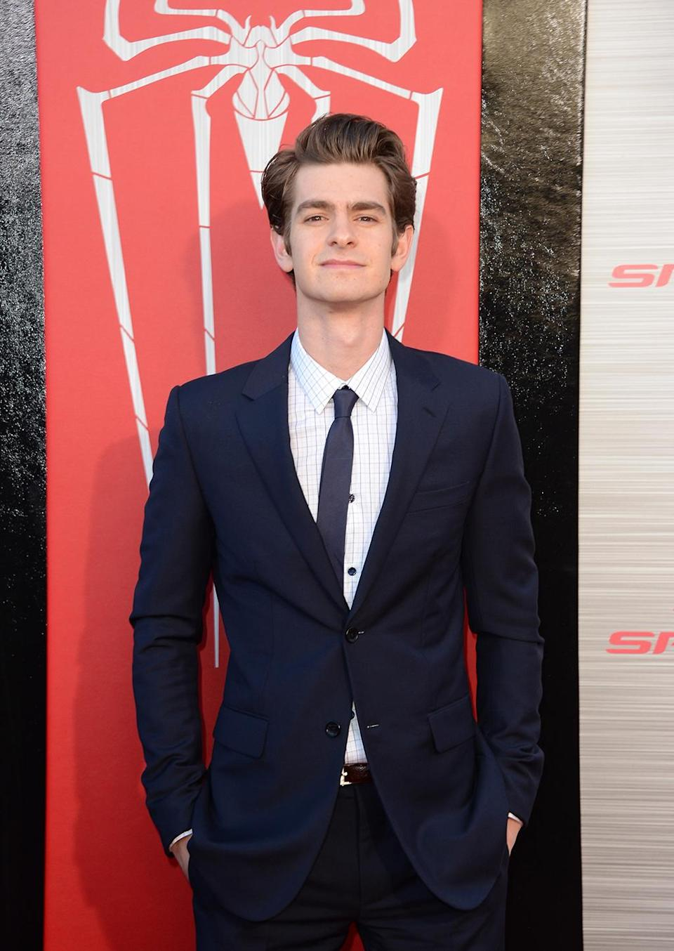 <p>After a five-year hiatus, <em>The Amazing Spider-Man</em> hit theaters with Andrew Garfield in the title role. He poses with the new Spidey logo at the premiere on June 28, 2012. (Photo: Jason Merritt/Getty Images) </p>