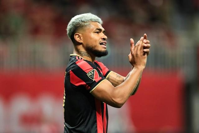 Atlanta United's Josef Martinez went down with an injury in the defending Major League Soccer champions' 3-1 home win Saturday over San Jose, ending his streak of MLS games with a goal at 15 (AFP Photo/Carmen Mandato)