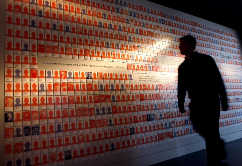 A man looks at a display of over 600 staff who worked and died on the Titanic, at SeaCity Museum in Southampton, England,Tuesday, April 3, 2012. The new museum will open in the City of Southampton on April 10, 100 years after the ill fated Titanic sailed from the City's docks. (AP Photo/Kirsty Wigglesworth)