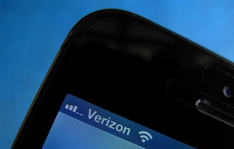 A photo illustration shows the Verizon wireless carrier icon on a mobile phone screen in Encinitas
