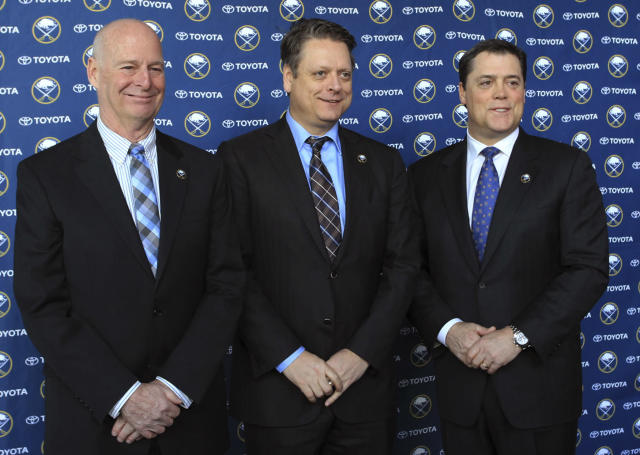 Craig Patrick, left, Tim Murray, center, and Pat LaFontaine pose for a photo after a news conference naming Murray as general manager of the Buffalo Sabres NHL hockey team and Patrick as special assistant and adviser to the hockey department, Thursday, Jan. 9, 2014, in Buffalo N.Y. LaFontaine is president of the team. (AP Photo/Nick LoVerde)