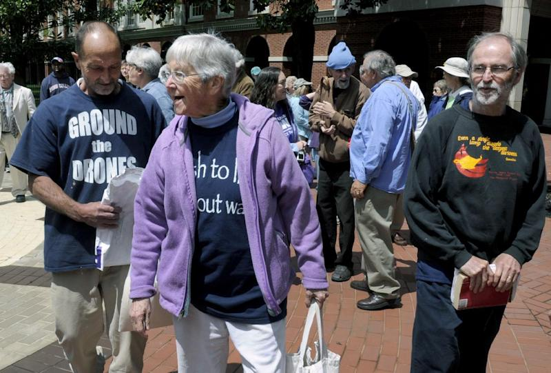 FILE - In this Monday, May 6, 2013, file photo, anti-nuclear weapons activists, from left, Michael Walli, Sister Megan Rice and Greg Boertje-Obed arrive for their trial in Knoxville, Tenn. All three were convicted on May 8, 2013, of interfering with national security when they broke into a nuclear weapons facility in Tennessee and defaced a uranium processing plant. The activists will learn Tuesday, Feb. 18, 2014, whether they will spend the next six to nine years in prison. (AP Photo/Knoxville News Sentinel, J. Miles Cary, File)