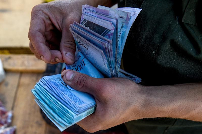 Hyperinflation has rendered Venezuela's currency almost worthless with a single dollar fetching more than three million bolivars on the black market (AFP Photo/Federico PARRA)