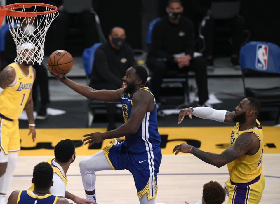 """<div class=""""inline-image__caption""""><p>Draymond Green #23 of the Golden State Warriors scores on a layup past LeBron James #23 of the Los Angeles Lakers during a 115-113 Warriors win on Martin Luther King Jr. Day at Staples Center on January 18, 2021, in Los Angeles, California. </p></div> <div class=""""inline-image__credit"""">Harry How/Getty</div>"""
