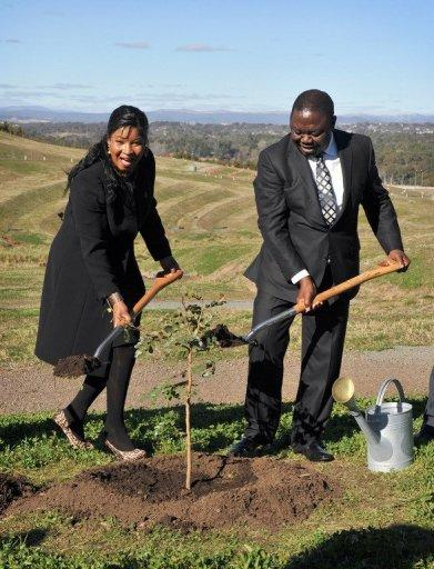 Zimbabwean Prime Minister Morgan Tsvangirai and his wife Elizabeth plant an African walnut tree during a visit to the the National Arboretum in Canberra, on July 23. Zimbabwe is ready to re-engage with the global community, Tsvangirai said during his visit to Australia which said it was open to easing sanctions