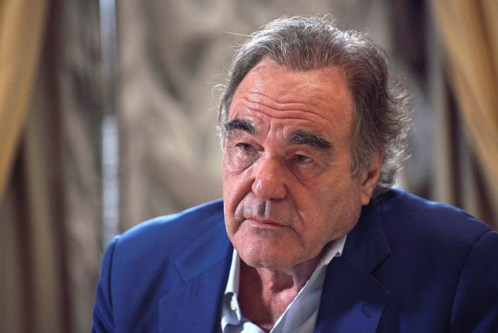 In this photo taken on Wednesday, June 19, 2019, and distributed by the Kremlin Press Service, US film director Oliver Stone listens during his interview with Russian President Vladimir Putin for his Revealing Ukraine documentary, in the Kremlin, Moscow, Russia. (Alexei Druzhinin, Sputnik, Kremlin Pool Photo via AP)