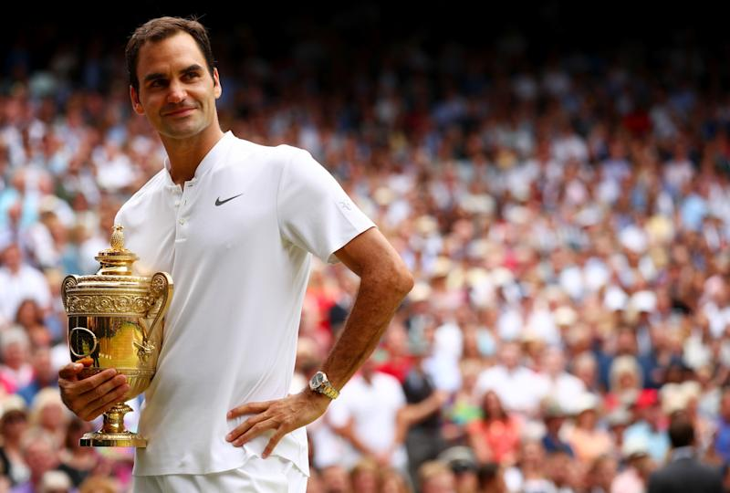 Holding court: Roger Federer with his eighth Wimbledon title