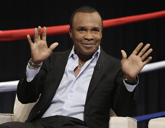 Boxing legend Sugar Ray Leonard waves during a news conference in New York, Wednesday, Jan. 14, 2015. NBC plans to air boxing matches on broadcast television beginning with an event on March 7, 2015. (AP Photo/Seth Wenig)