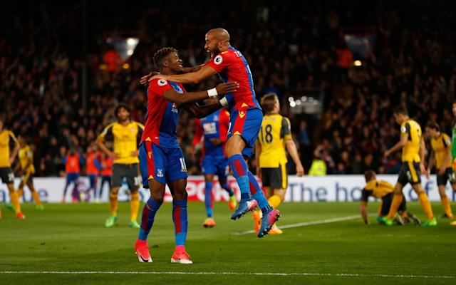 Andros Townsend and Wilfried Zaha celebrate the opening goal in their 3-0 win - REUTERS